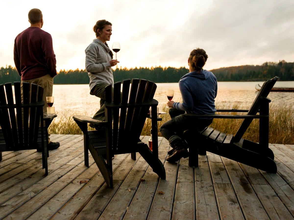 Friends drinking wine on a dock