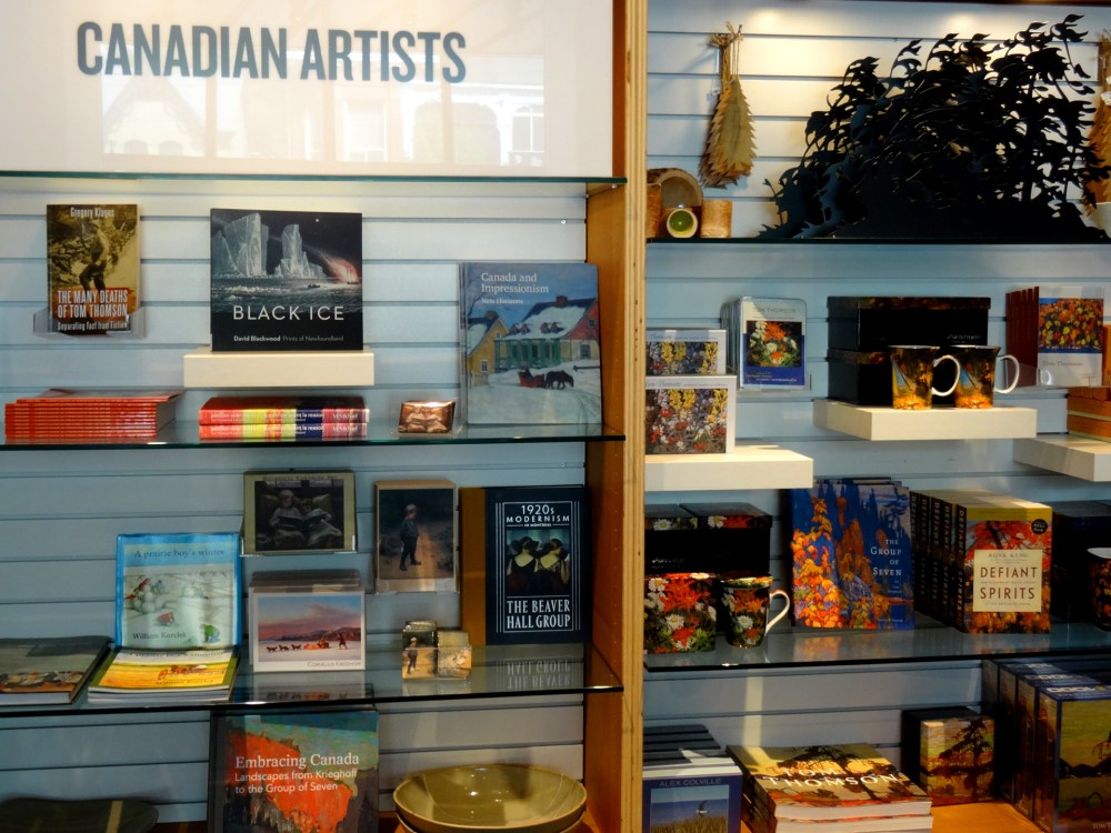 Shelves of books and gifts featuring Canadian art.