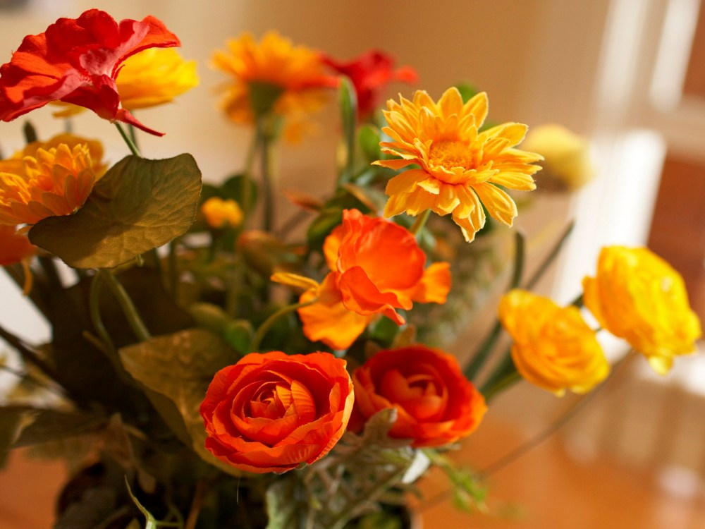 Vase of lovely yellow and orange flowers