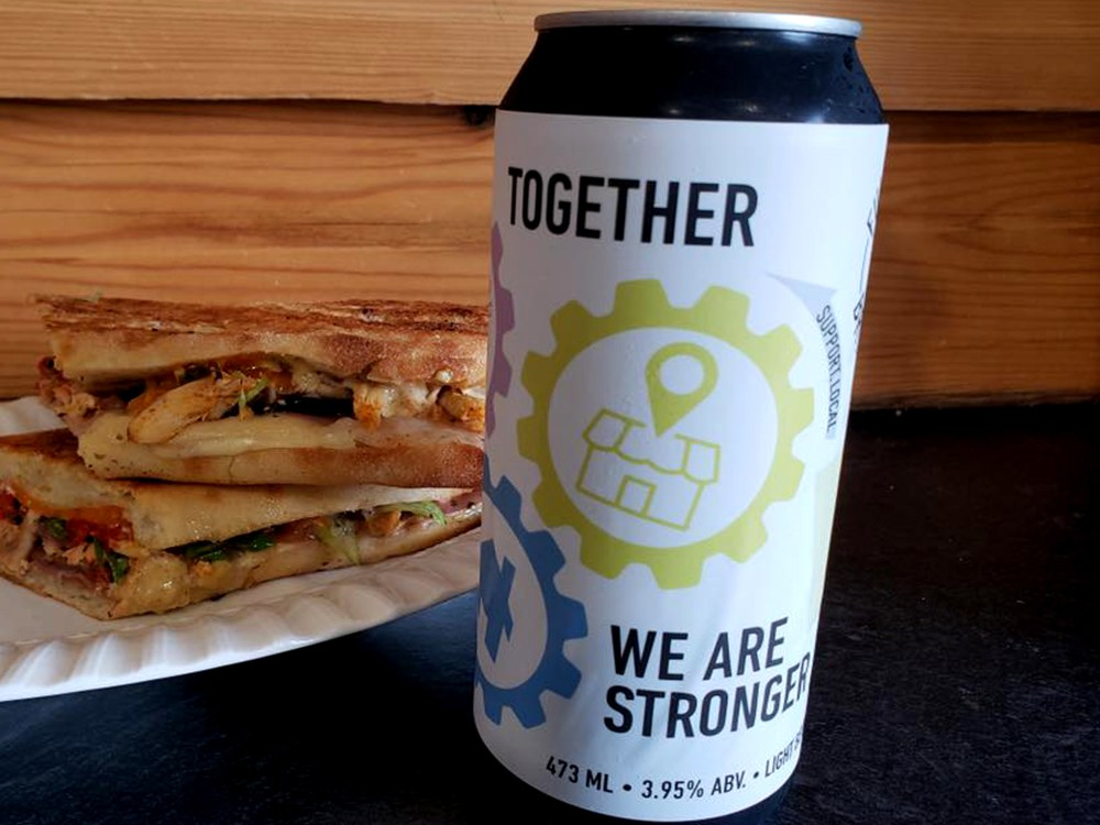 Can of beer and a grilled sandwich