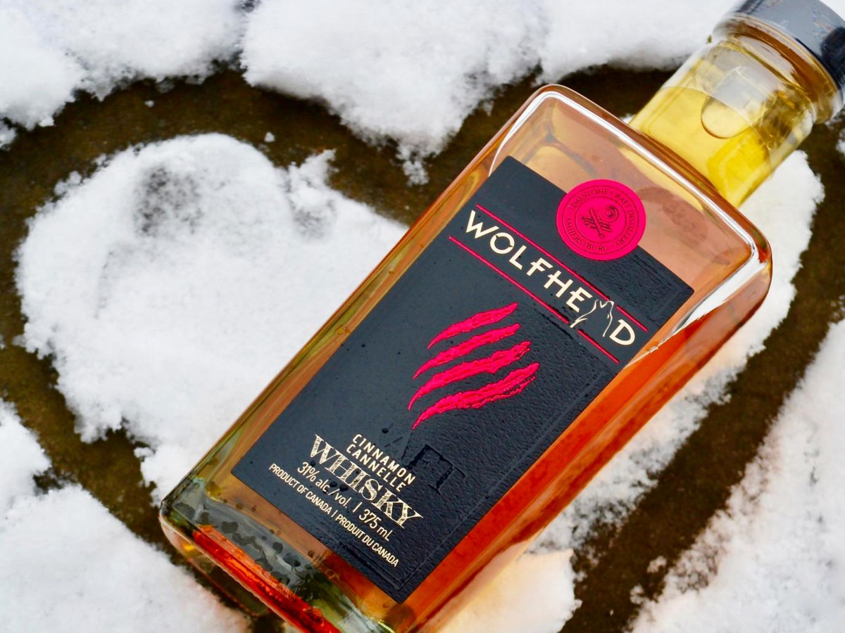 Bottle of whisky lying in the snow