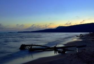 Driftwood beach at sundown.