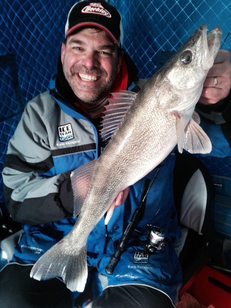 Keith Kavajecz with a walleye in ice shelter: Early ice is a good time for aggressive actions. In most cases, the walleyes are still putting on the feedbag for winter (especially in a situation where you've had an early freeze) and they're typically in a more aggressive feeding mode.