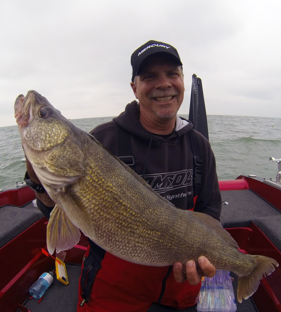 Gary Parsons with a Walleye:  To accomplish ideal boat control walleye anglers have many tools at their disposal, but one boat control device we have come to rely on a great deal the past couple seasons is a paddle … bet that gets your attention!