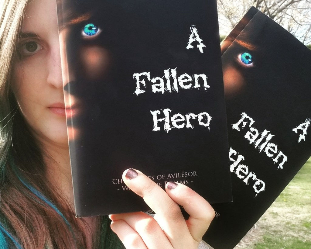 Author Sara A. Noë holding copies of A Fallen Hero published by IngramSpark and Barnes & Noble Press