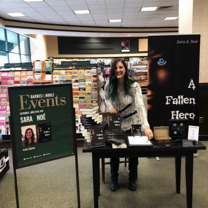 Author Sara A. Noë with her novel A Fallen Hero at Barnes & Noble in Lafayette, Indiana