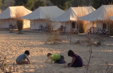 kids playing in the desert sand