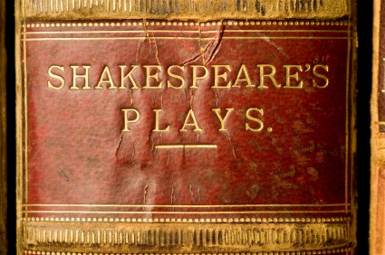 The title plate on the spine of an antique book of the plays of Shakespeare