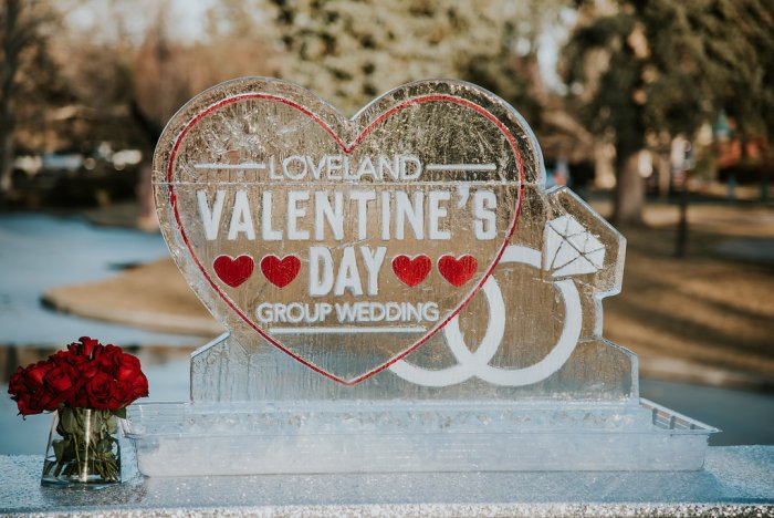 Join On The Rocks mobile bar and tap at Loveland's Annual Valentine's Day Group Wedding! Photo shows an intricate ice sculpture featuring the event's logo.