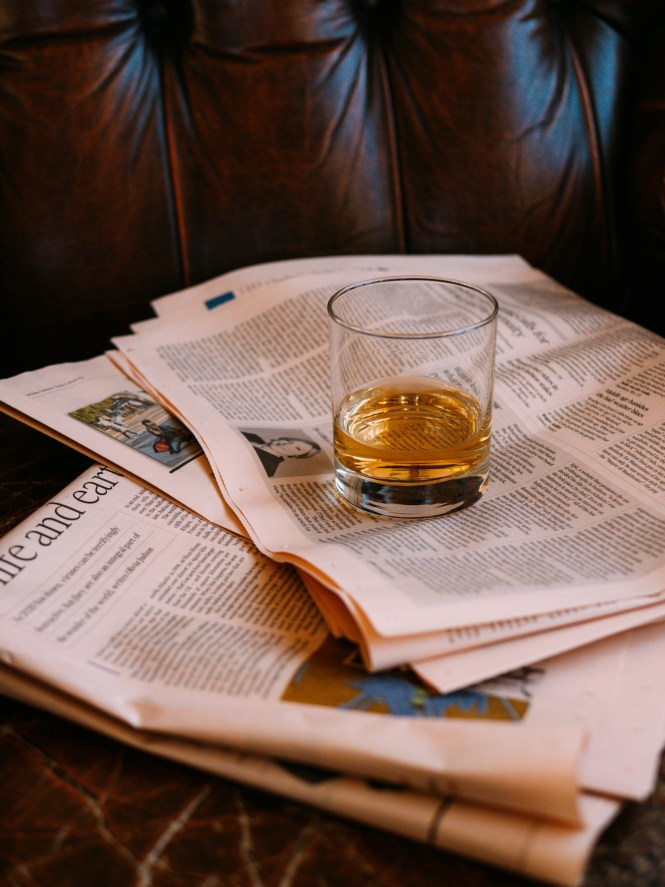 whisky glass on a leather armchair