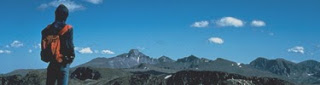 ROMO_hiker-longs-background1