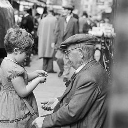 John Gay (1957 - 1962) A young girl and a man wearing a flat cap in Petticoat Lane Market
