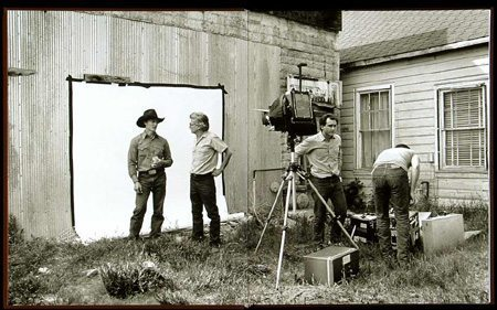 Richard Avedon shooting on location at a country fair with 8x10 camera and assistants.