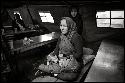 Marie Dorigny (2015) Passau train station, Germany. Refugees await for the final train journey to a host town in Germany, one they have not chosen themselves.