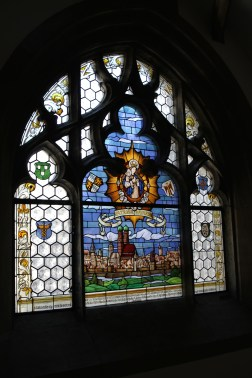 Beautiful little Bavarian scene on a stained glass window