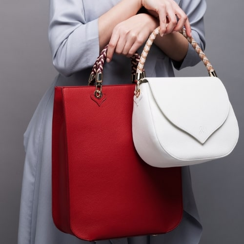 Red leather tote handbag and white leather shoulder bag, Illicia Onwards and Up London