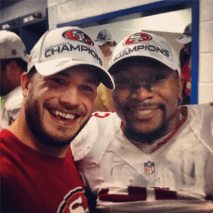 Nate Stupar (left) and NaVorro Bowman celebrate after the NFC Championship.