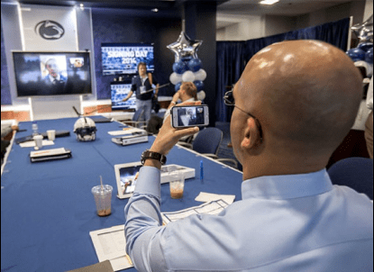 Franklin Facetimes with a recruit (Photo: Harvey Levine/Fight On State)