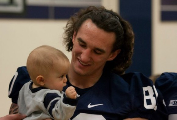 Receiver Matt Zanellato makes a new friend. (Photo by: Bobby Chen)