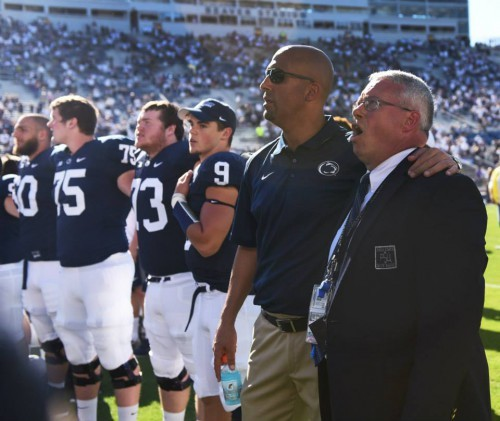 Coach Franklin invited Dr. Bundy to sing the alma mater with the team on the field after the Homecoming game against Northwestern. Photo: Annemarie Mountz.