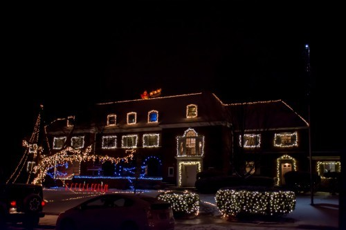 Delta Chi decorates its lawn with candy canes, with a Santa seen on its roof.