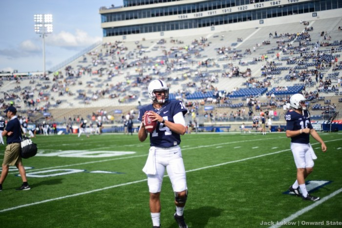 Hackenberg warms up on the field.