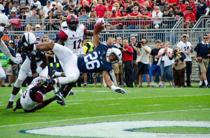 Saquon Barkley flies into the end zone during the first quarter to put the Nittany Lions up 7-0.
