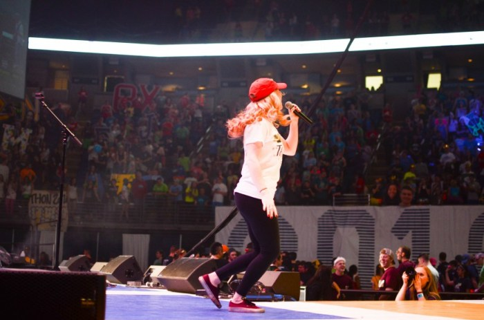 A performer keeps the crowd excited and alive during the long hours of THON.
