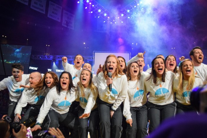 The THON Committee Captains excitedly announce for the dancers to finally sit down.