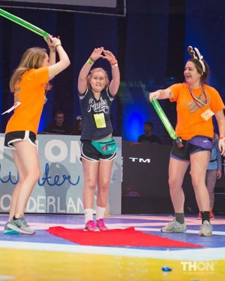 Penn State Student and Phi Mu THON Child Maddie Hill energizes the crowd during a THON Weekend performance (Photo: THON)