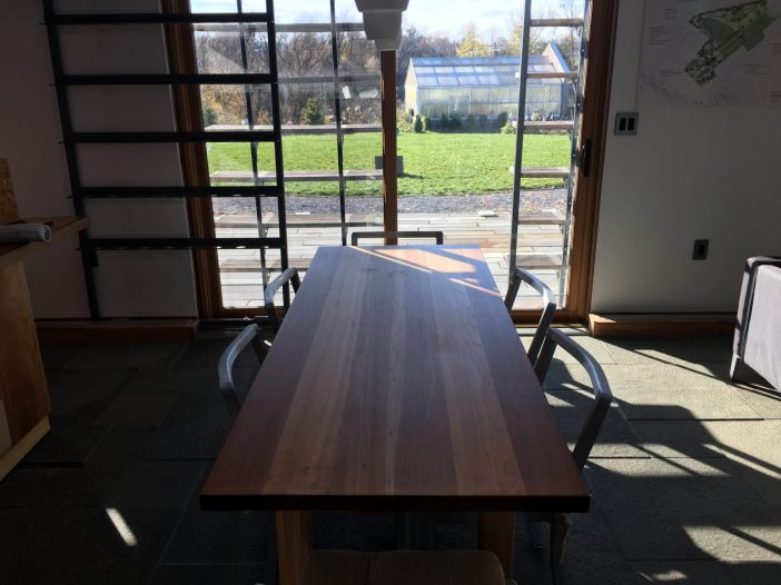 The dining room table of the home was made by seniors in the Forestry school from a tree cut down on Old Main sometime in the early 2000's.