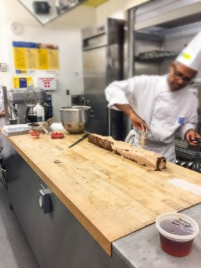 Chef is masking the roll with buttercream.
