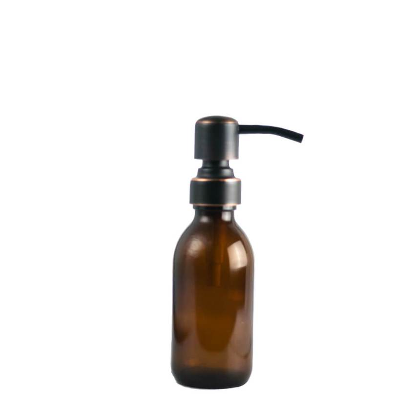 Small reusable glass bottle with metal pump