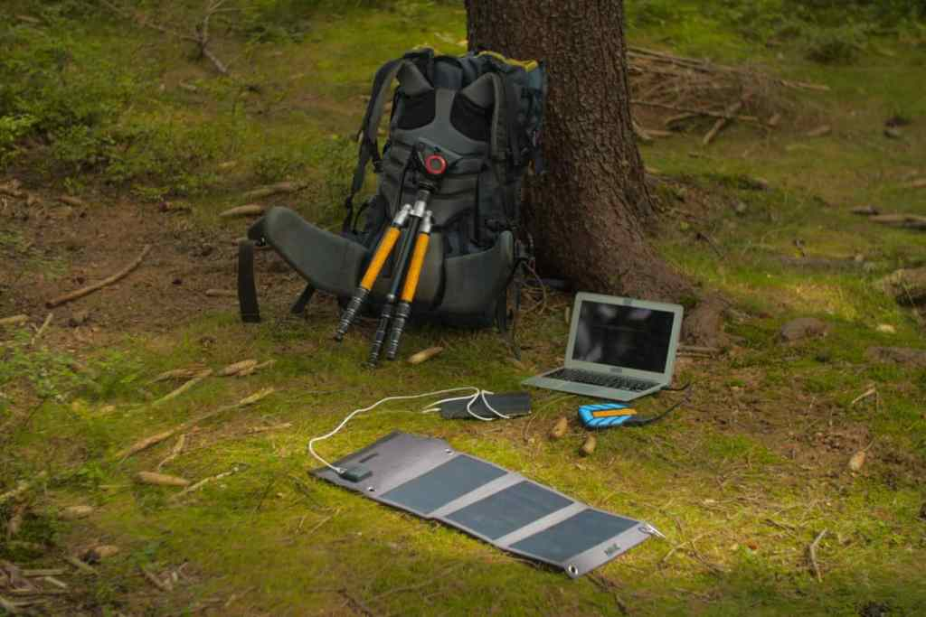 solar panel charging a laptop
