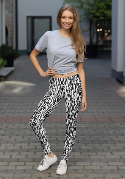 "Woman wearing Zouk Leggings decorated with a unique ""Animalistic Zouk"" design by Ooh La La Zouk. Lifestyle view in sneakers."