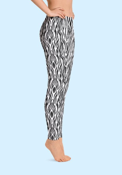 "Woman wearing Zouk Leggings decorated with a unique ""Animalistic Zouk"" design by Ooh La La Zouk. Right side view (1) barefoot."