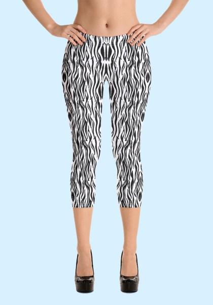 "Woman wearing Zouk Capri Leggings decorated with a unique ""Animalistic Zouk"" design by Ooh La La Zouk. Front view (3) high heels."