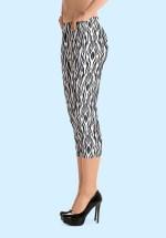 "Woman wearing Zouk Capri Leggings decorated with a unique ""Animalistic Zouk"" design by Ooh La La Zouk. Left view (3) high heels."
