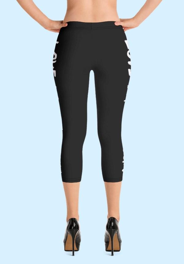 "Woman wearing Capri Zouk Leggings decorated with a unique ""Love Dance Zouk"" design. Back view (3) high heels. By Ooh La La Zouk."