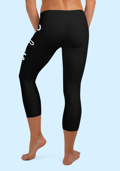 "Woman wearing Capri Zouk Leggings decorated with a unique ""Zouk me"" design. Back view (2) barefoot. By Ooh La La Zouk."