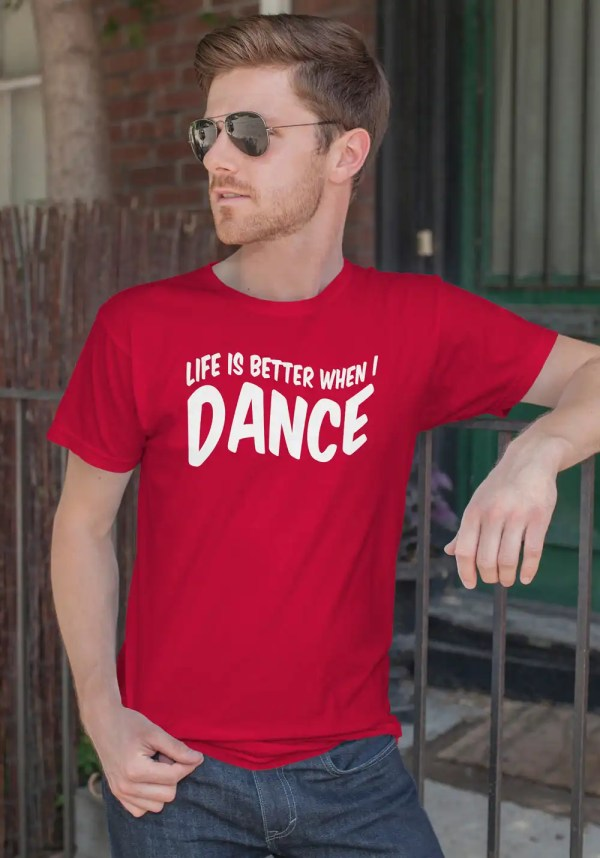 """Man wearing Zouk T-shirt decorated with unique """"Life is better when I Dance"""" design in red crew neck style"""