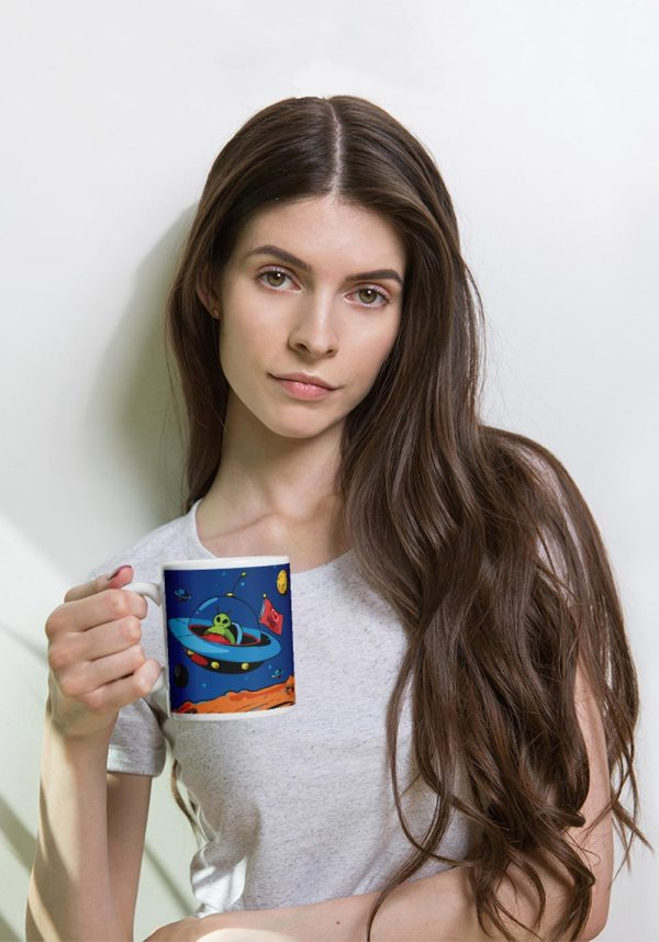 Woman holding a fun, unique, I Love Mars mug to proudly celebrate the greatest and most challenging endeavour humanity has ever embarked on. For the first humans to live and work on Mars