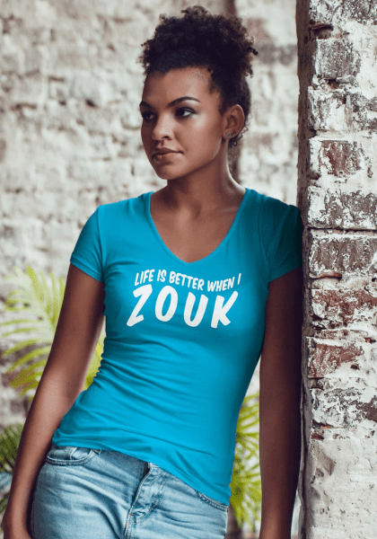 """Woman wearing Zouk T-shirt decorated with unique """"Life is better when I Zouk"""" design in blue v-neck style"""