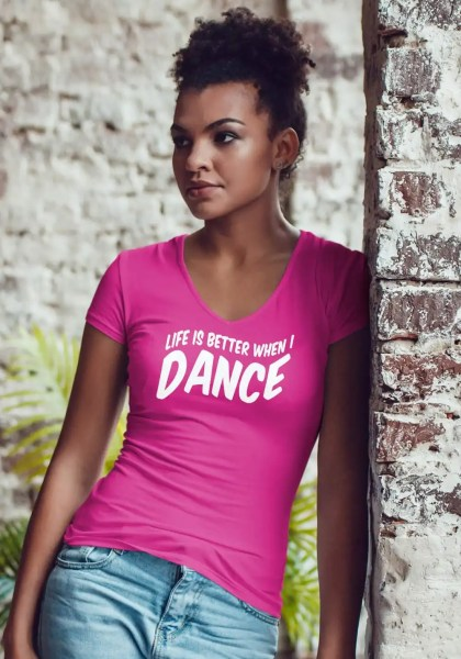 "Woman wearing Zouk T-shirt decorated with unique ""Life is better when I Dance"" design in pink v-neck style"