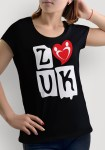 """Woman wearing Zouk T-shirt decorated with """"deeply connected Zouk Dancers in a unique heart design (black, crew neck style) close-up"""