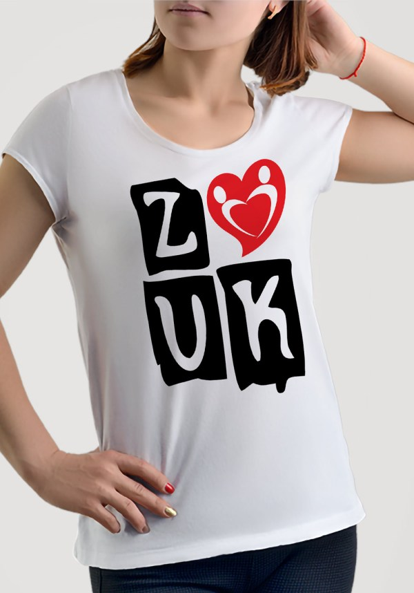 """Woman wearing Zouk T-shirt decorated with """"deeply connected Zouk Dancers in a unique heart design (white, crew neck style) close-up"""