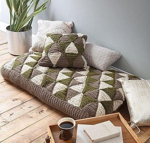 floor poufs and crochet pillows