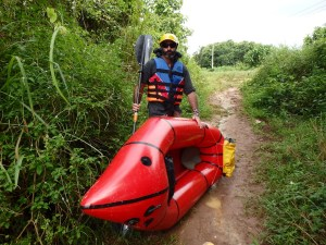 Stu and his pack raft 'The Mekong Queen' on testing day