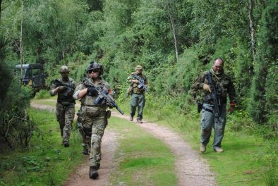 Airsoft players moving down a path