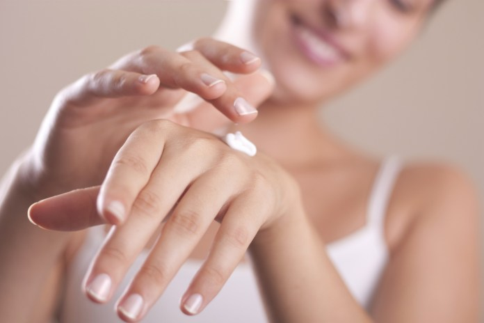 applying hand lotion